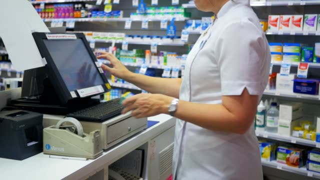 cash register close up of a pharmacist processing a transaction at a cash register in an australian pharmacy register stock videos & royalty-free footage