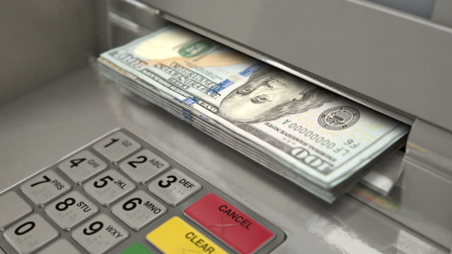 Cash Withdrawel DOLLAR A closeup view of an atm facade with an illuminated sceen and keypad and a wad of US dollar banknotes being ejected from the cash slot paper currency stock videos & royalty-free footage