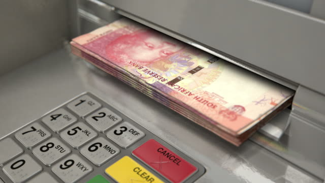 Cash Withdrawel RAND A closeup view of an atm facade with an illuminated sceen and keypad and a wad of south african rand banknotes being ejected from the cash slot banks and atms stock videos & royalty-free footage