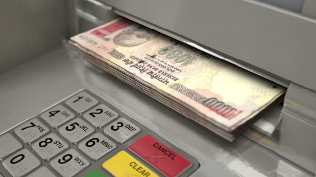 Cash Withdrawel RUPEE A closeup view of an atm facade with an illuminated sceen and keypad and a wad of indian rupee banknotes being ejected from the cash slot banks and atms stock videos & royalty-free footage