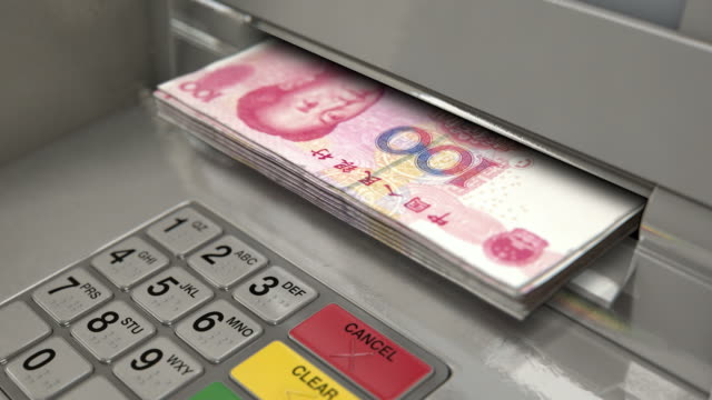 Cash Withdrawel YUAN A closeup view of an atm facade with an illuminated sceen and keypad and a wad of yuan banknotes being ejected from the cash slot banks and atms stock videos & royalty-free footage