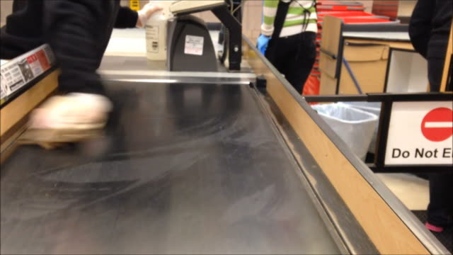 Cashier cleaning the checkout food belt video