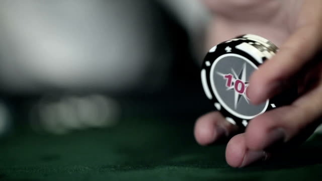 Casino: Man excited, turns casino tokens in hand video