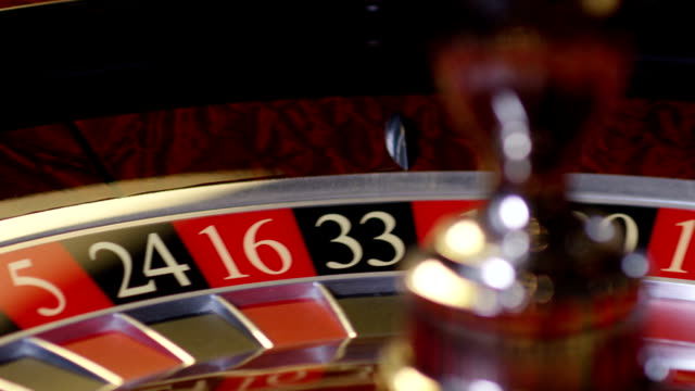 casino roulette in motion, the spinning wheel ball . with camera motion . shot on red epic dragon cinema camera in slow motion. - sorte video stock e b–roll