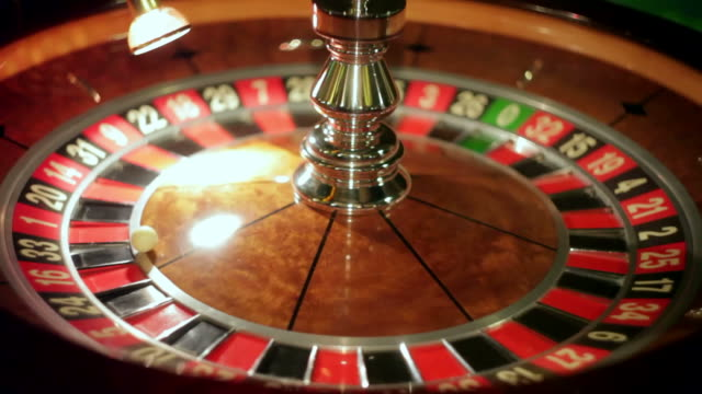 casino: roulette, the girl spins the ball, slow motion video