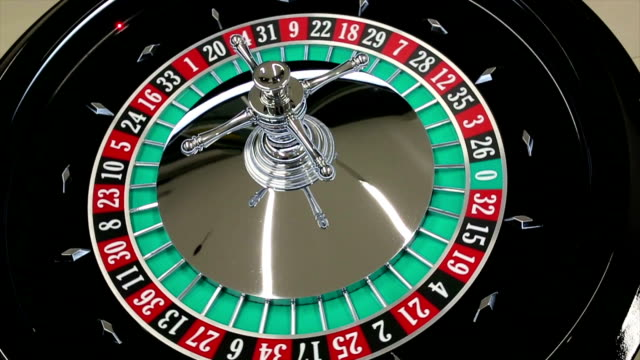 Casino roulette wheel with the ball on number 26 video