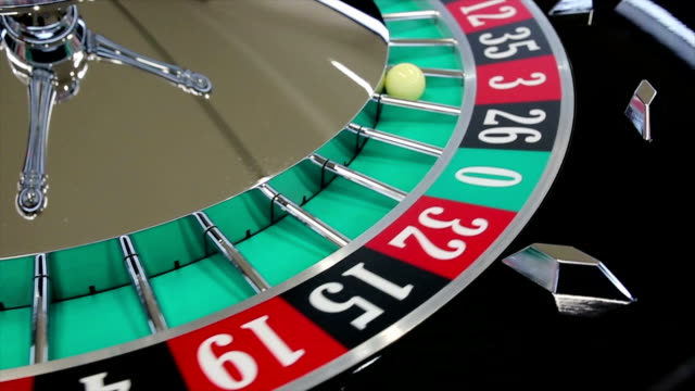 Casino roulette wheel with the ball on number 3 video