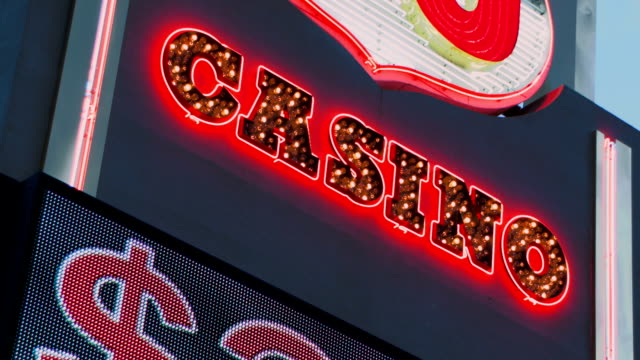 Casino Sign Dutch angle A blinking casino sign in Las Vegas, Nevada monte carlo stock videos & royalty-free footage