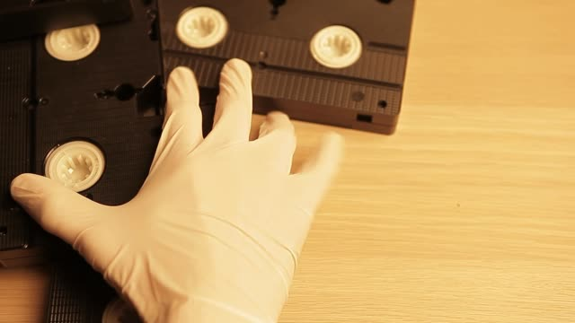 VHS cassette clapper board wooden table hand white gloves hd footage VHS cassette clapper board wooden table hand white gloves hd footage backup stock videos & royalty-free footage
