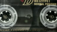 istock Cassette recorder tape running - close setting 1276451550