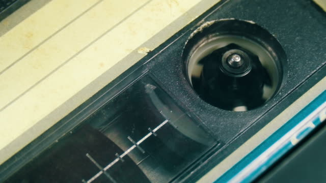 cassette tape with a white blank label - disco audio analogico video stock e b–roll