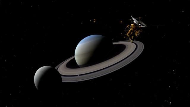 cassini satellite , enceladus, and saturn - mitologia video stock e b–roll