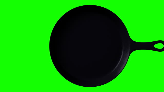 Cast iron skillet on green chroma key 3DCG render animation. frying pan stock videos & royalty-free footage