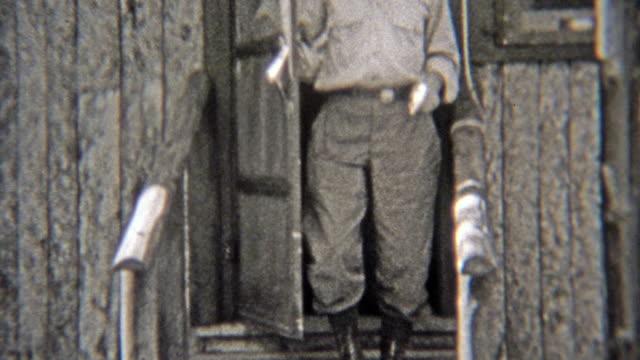 1938: charaktere verlassen ein ferien-blockhaus. - editorial videos stock-videos und b-roll-filmmaterial