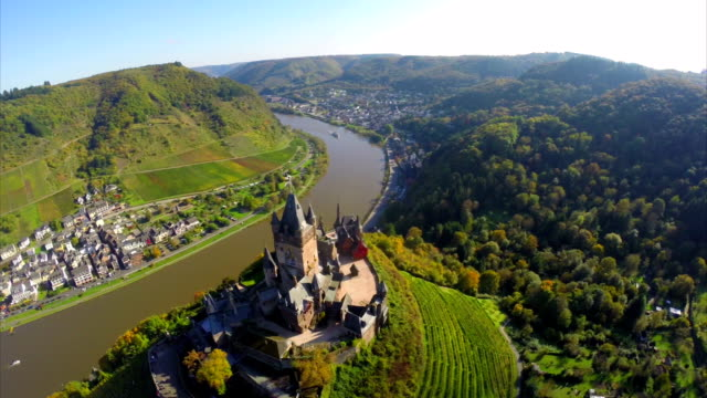Castle aerial vine hills, river ships, medieval village Germany. Beautiful aerial shot above Europe, culture and landscapes, camera pan dolly in the air. Drone flying above European land. Traveling sightseeing, tourist views of Germany. video