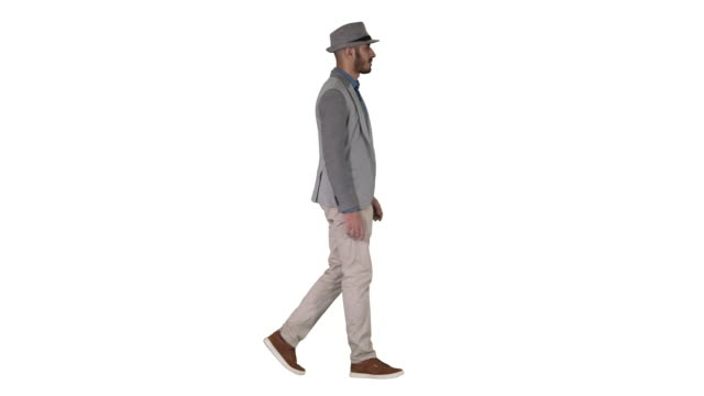 Casual arabic man in hat walking on white background