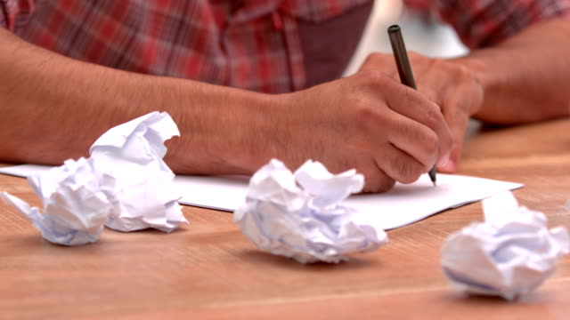 Casual businessman writing notes on paper video