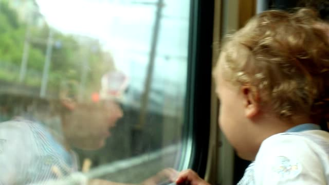 Casual candid shot of mother and baby together on train. Mom kissing tired exhausted baby from commute. Baby wanting to sleep Casual candid shot of mother and baby together on train. Mom kissing tired exhausted baby from commute. Baby wanting to sleep arthropod stock videos & royalty-free footage