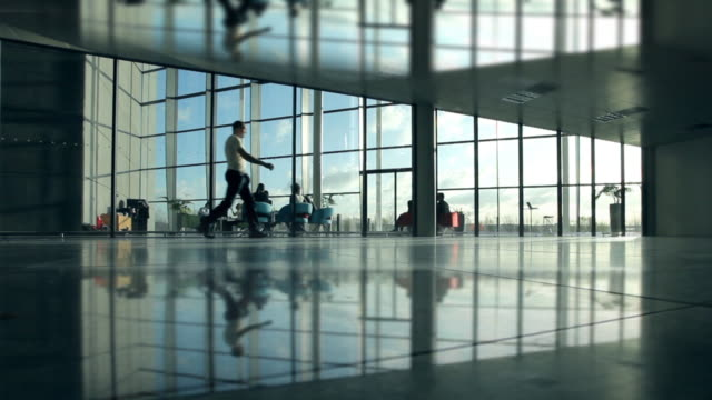 Casual man in airport style environment  lobby stock videos & royalty-free footage