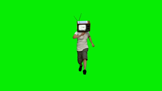 Casual man in shorts running with a TV head, against Green Screen Casual man in shorts running with a TV head, against Green Screen alpha channel stock videos & royalty-free footage