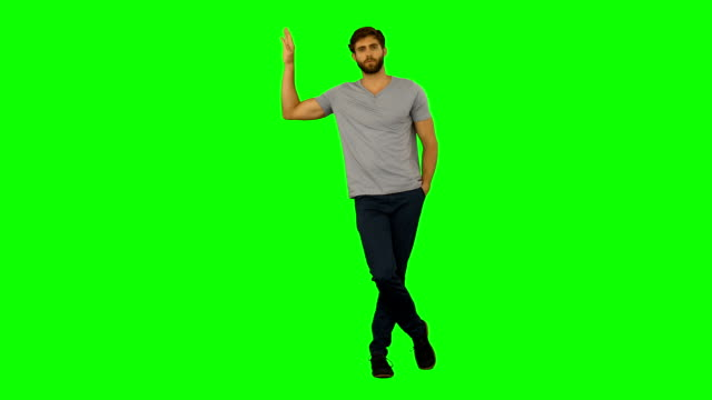 Casual man standing and leaning Casual man standing and leaning on green screen background leaning stock videos & royalty-free footage