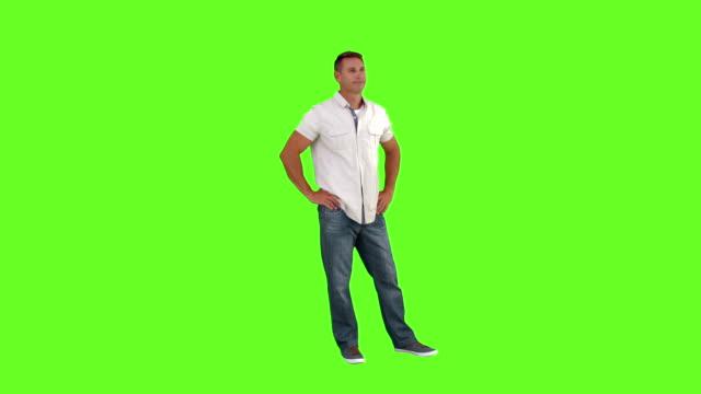stockvideo's en b-roll-footage met casual man standing with hands on hips - handen op de heupen