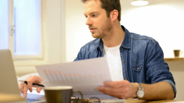 Casual man working on documents video