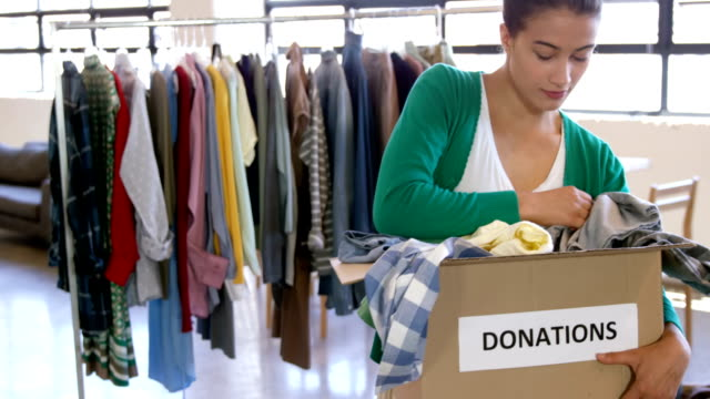 Casual woman looking at donations video