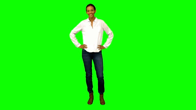 Casual woman smiling at camera Casual woman smiling at camera on green screen background arms akimbo stock videos & royalty-free footage