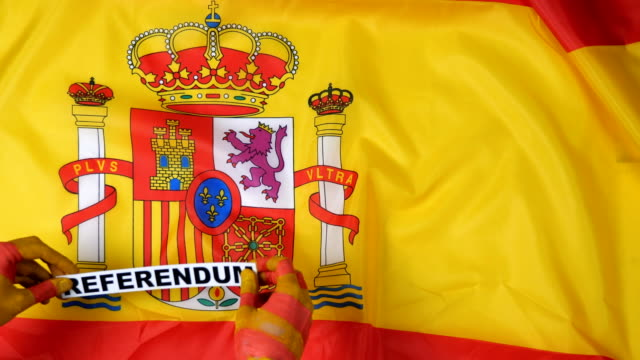 Catalan hands put the card - referendum on the flag of Spain video