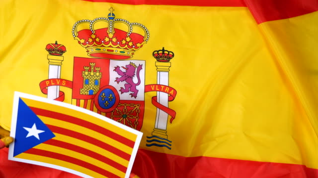 Catalan hands put the flag of Catalonia on the flag of Spain video