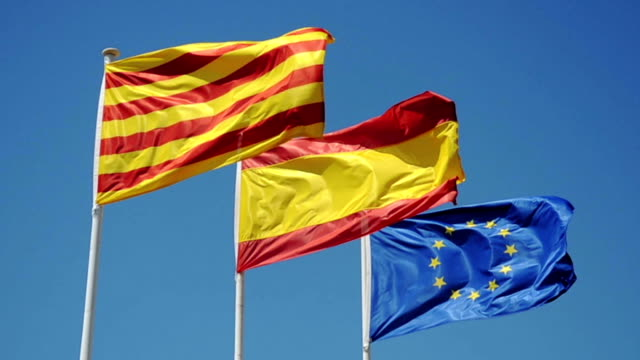 Catalonia, Spain and Europe flags Flags on blue sky lleida stock videos & royalty-free footage