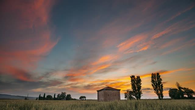 Catalonia, Spain. Sunset Sky Above Spanish Countryside Rural Wheat Field Landscape. Lonely Barn Farm Building Farmhouse