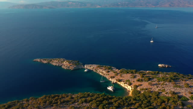 catamarans and yachts anchored in the bay of the - isole egee video stock e b–roll