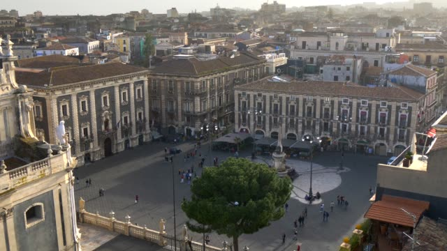 Catania, Sicily, Italy. Piazza Duomo (Cathedral Square) . Zoom out shot in daytime.