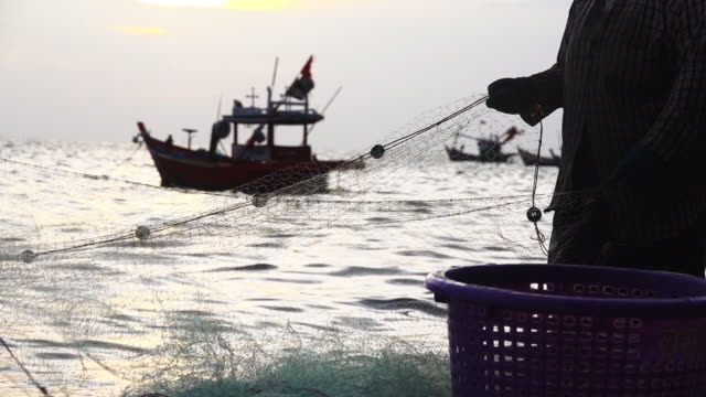 Catching fish with trawl use by fishermen