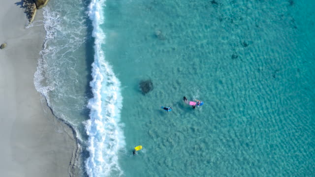 catching waves - aerial beach stock videos & royalty-free footage