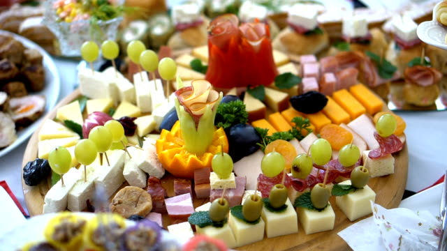 catering buffet style with different light snack - buffet video stock e b–roll