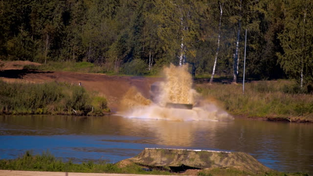 Caterpillar floating conveyor PTS-м swims river with a military truck on a board video