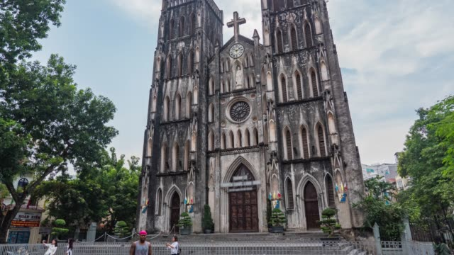 cathedral church of st. joseph in hanoi with tourisms, time lapse video - cathedrals stock videos & royalty-free footage