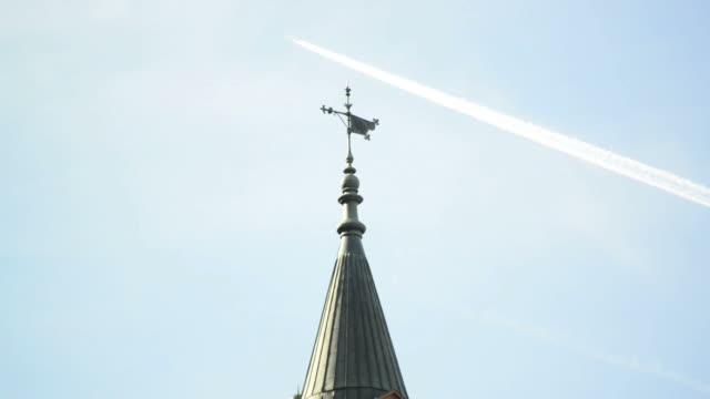 Cathedral roof and the jetplane on blue sky video