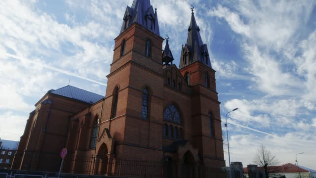 catholic church and sky tilt up - medieval architecture stock videos & royalty-free footage