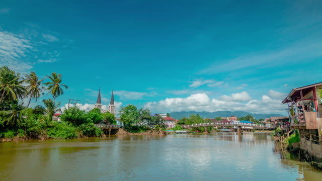 Catholic Church in Chanthaburi riverside community with clouds moving. video