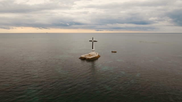 Catholic cross in the sea