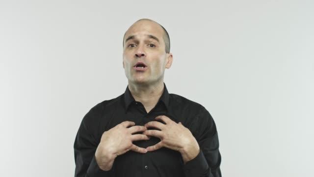 Caucasian adult salesman oathing at camera