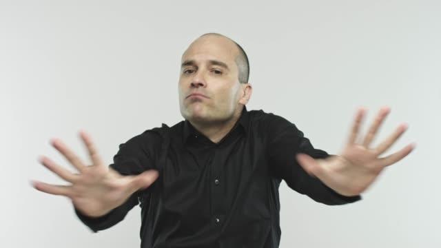 Caucasian adult speaker convincing at camera