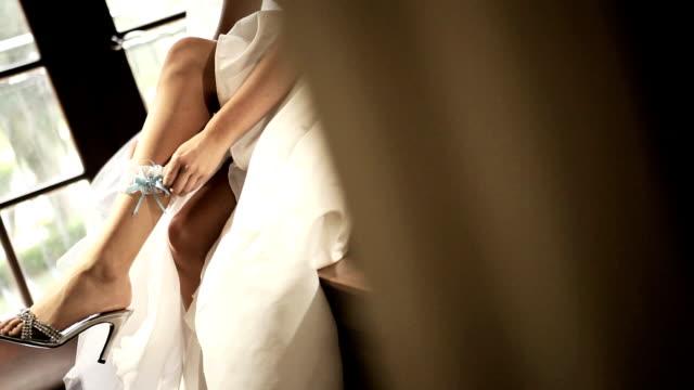 Caucasian Bride Wearing Wedding Garter video
