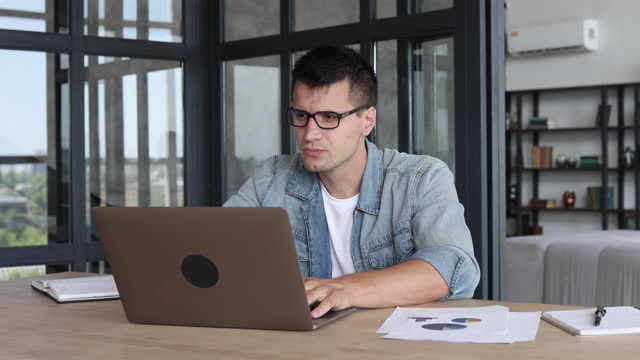 Caucasian businessman takes off glasses from his eyes and massaging the bridge of the nose, relieves eye strain, from long-term work at a laptop computer, overwork, dry eyes concept Caucasian businessman takes off glasses from his eyes and massaging the bridge of the nose, relieves eye strain, from long-term work at a laptop computer, overwork, dry eyes concept russian ethnicity stock videos & royalty-free footage