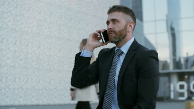 caucasian businessman with cellphone - call center стоковые видео и кадры b-roll