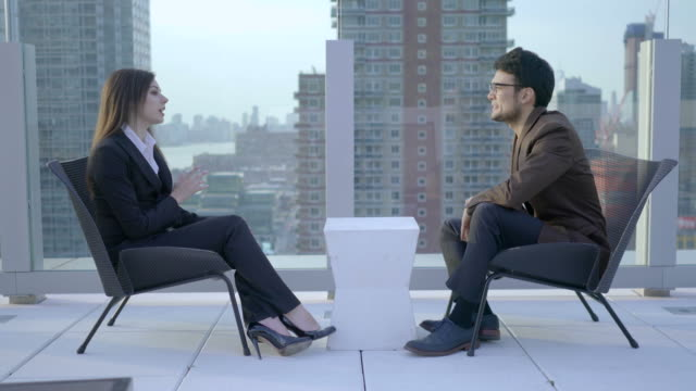Caucasian Businesswoman and Asian Colleague Discussing Work. People With Black Hair and Business Clothes. video
